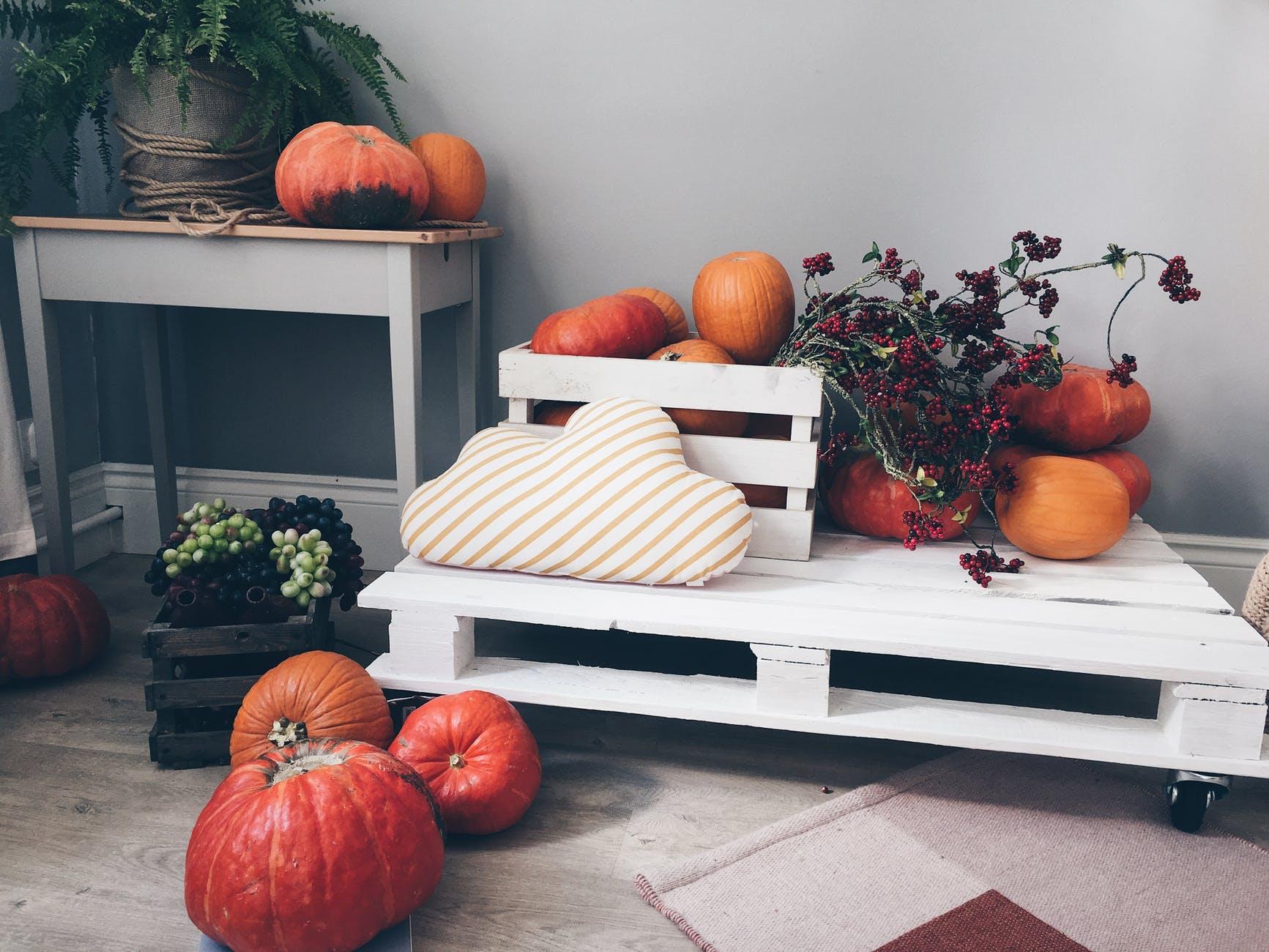orange pumpkin lot on white pallet board