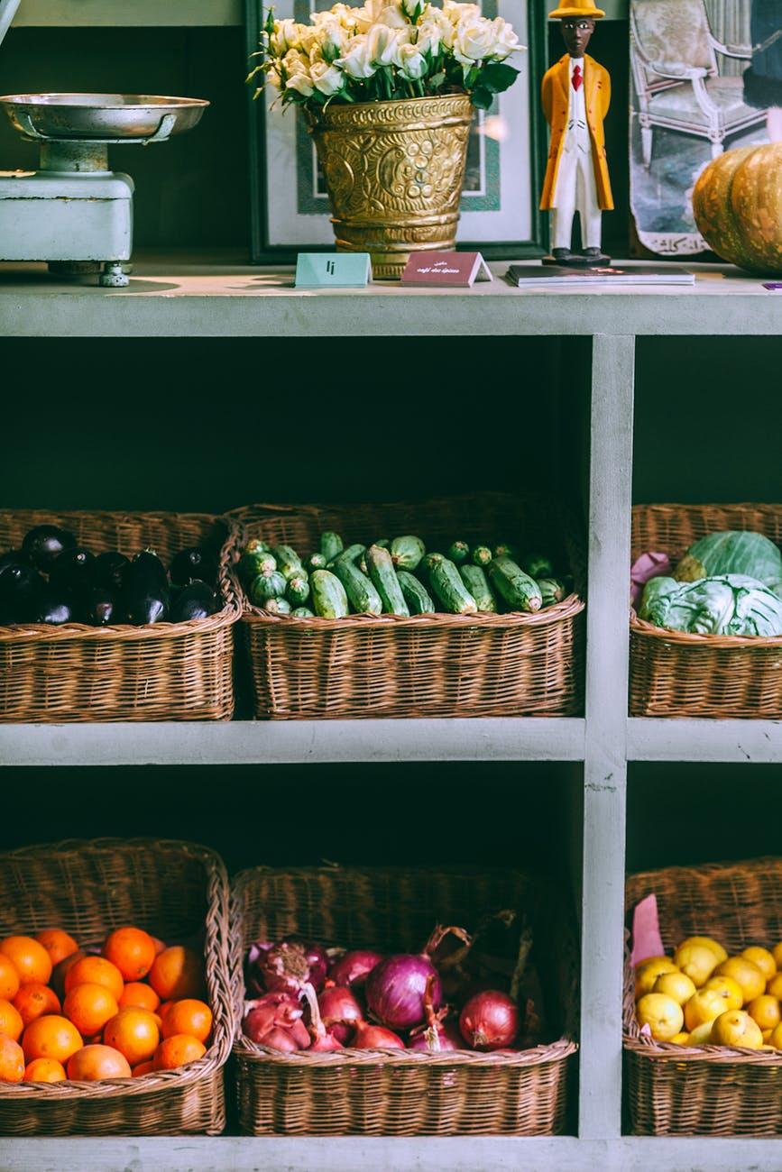 assorted fruits and vegetables on market rack